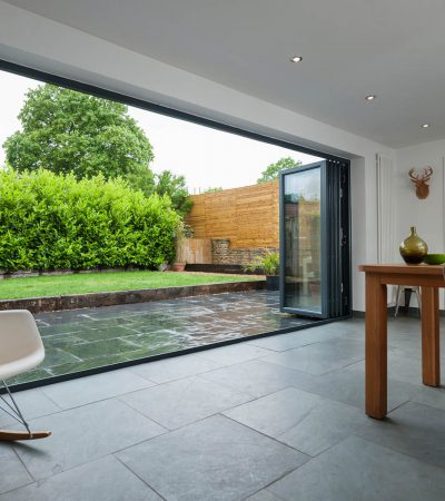 modern specialised doors open a full side of a house up to the outside