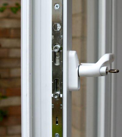 close up of locking system on white casement window